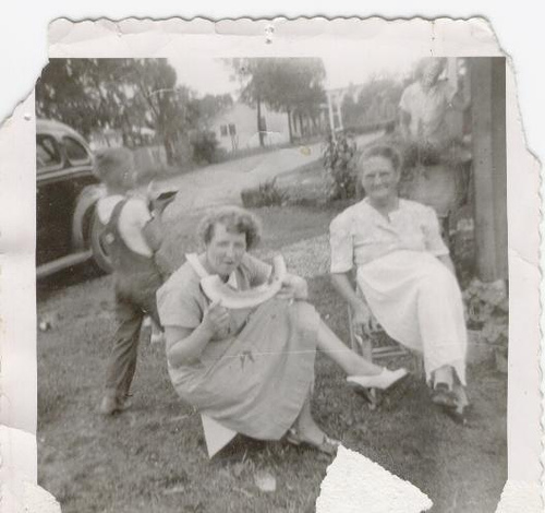 Granny eating watermelon in black and white