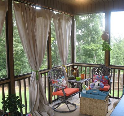 Add privacy to a porch using Copper piping for curtain rods with canvas drop cloths for curtains. Add rope lighting for ambiance.