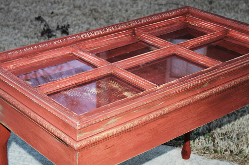 Red distressed table made from an old window