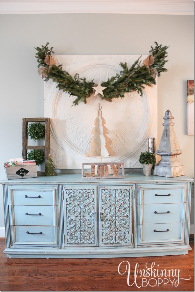 Happy blue distressed dresser in a living room