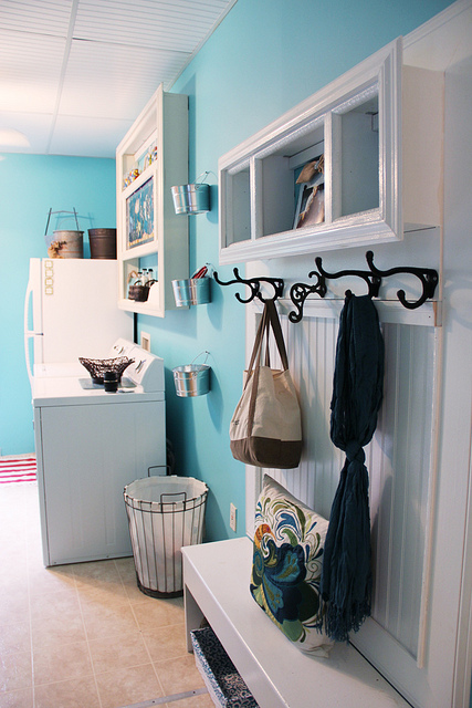 aqua blue laundry room with mud bench
