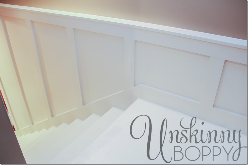 The primed staircase, ready for colorful paint to finish the project.