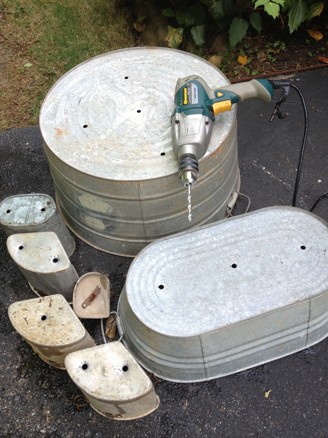 drilling holes in galvanized tubs