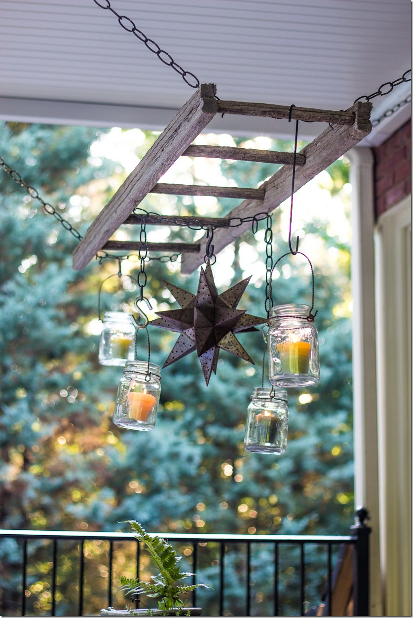 Use a ladder and mason jars for lighting over a patio table