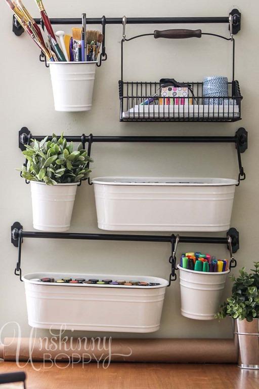 white buckets holding craft supplies