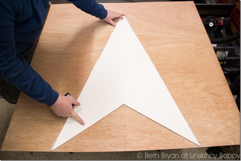 Trace the star template on the sheet wood five times, for all five points of the star.