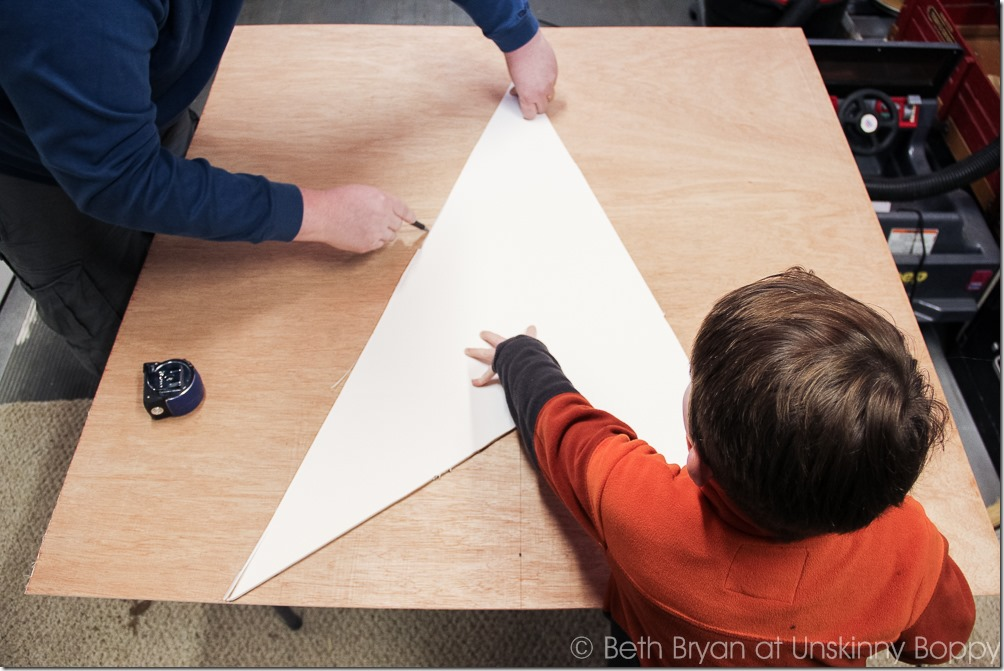Get yourself a helper! Carefully trace the star point template on the sheet wood.