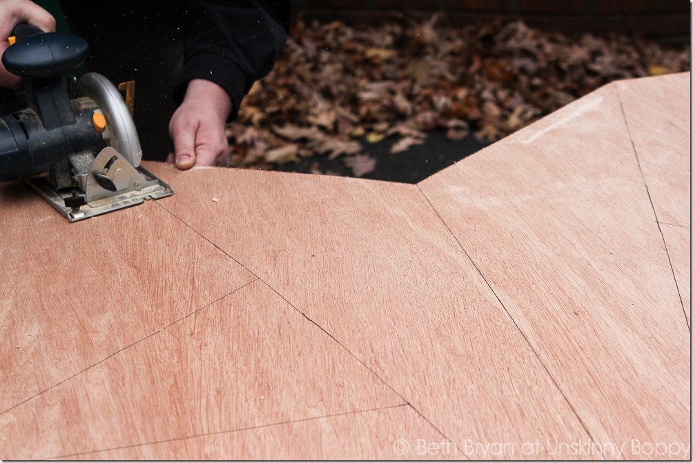 Carefully use an electric saw to cut out the traced star lines. Keep the kids away from this part!