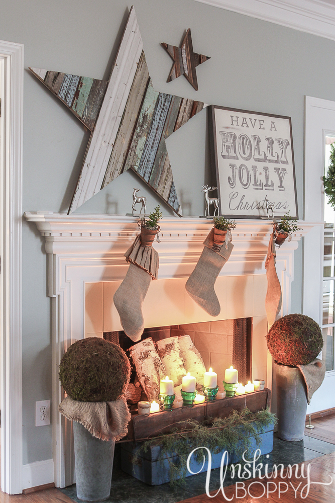 Have a Holly Jolly Christmas! Love that giant reclaimed wood star.