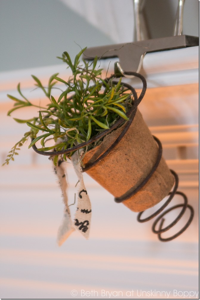 Cute Bedspring planter on a Christmas mantel