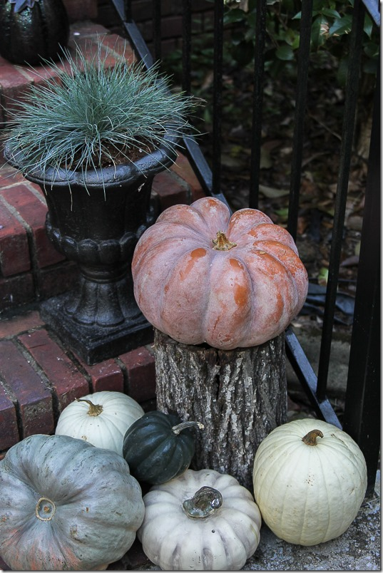 Decorating porches for Fall with pumpkins and planters