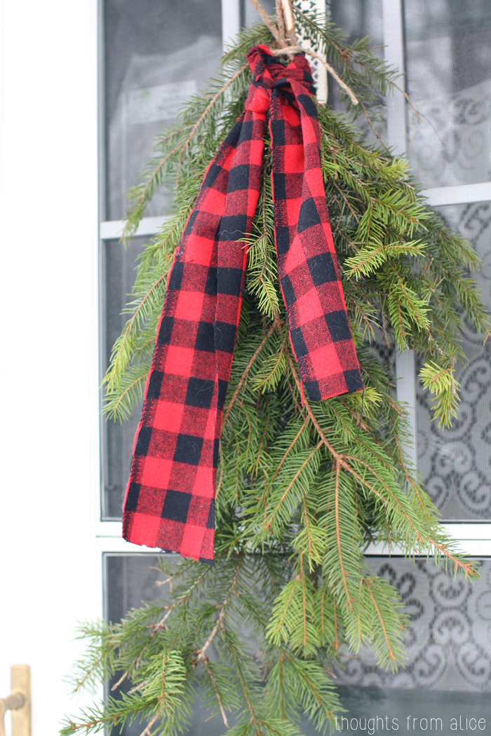 Evergreen-Boughs-with-Plaid-Door-Wreath