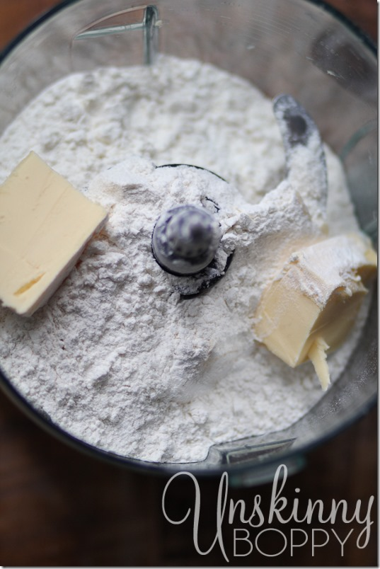 Mix the dry ingredients with butter in a food processor.