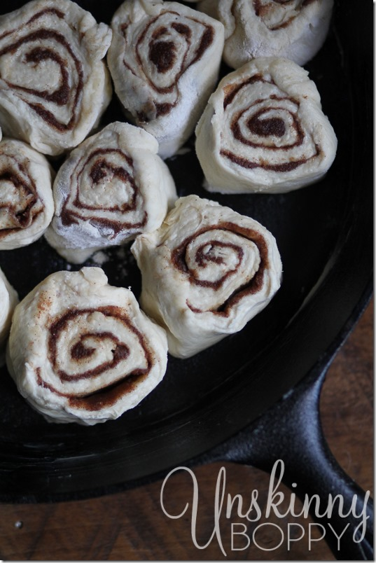 Cut the rolled dough into 1 inch slices and arrange them in a skillet.