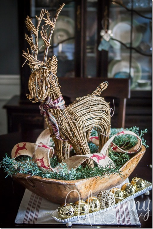 Dough bowl with a twig reindeer and greenery- simple centerpiece idea.