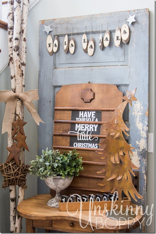 So many great things happening in this photo!  Love the wood slice bunting and the vintage church sign with