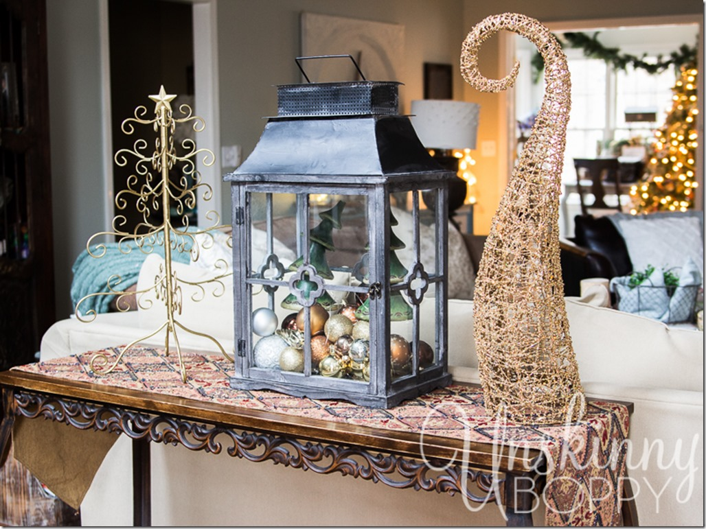 Pretty lantern filled with ornaments and lights