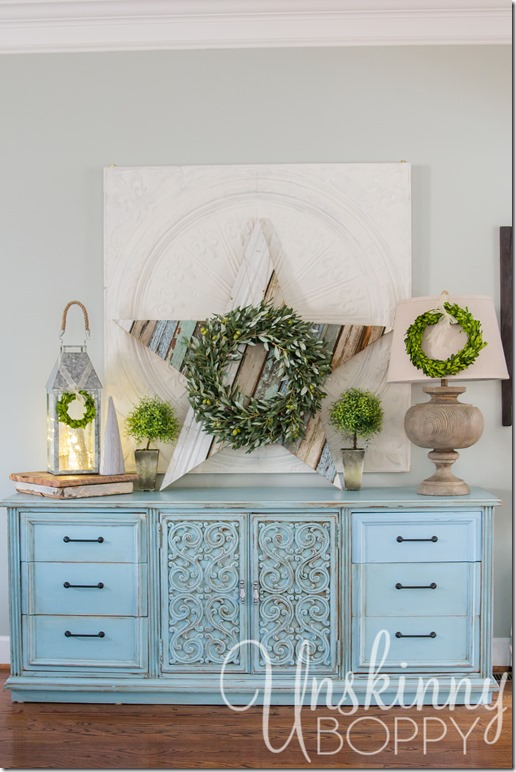 Pretty Christmas decorations. Love that giant reclaimed wood star!!