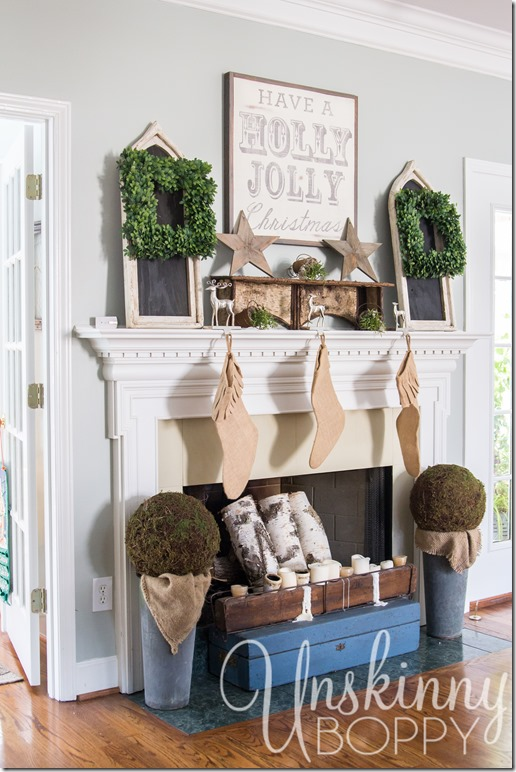 Christmas mantel with boxwood wreaths