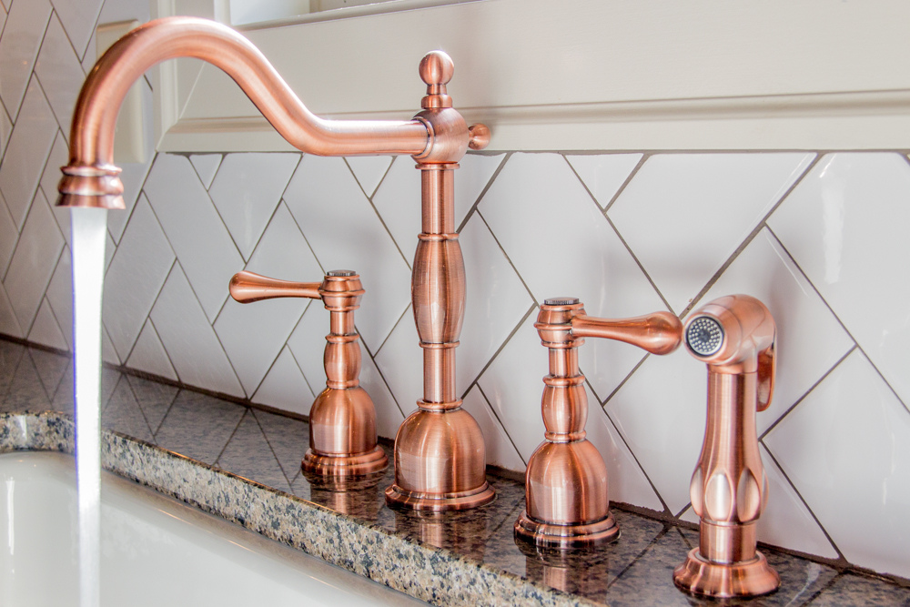 copper faucet by signature homes