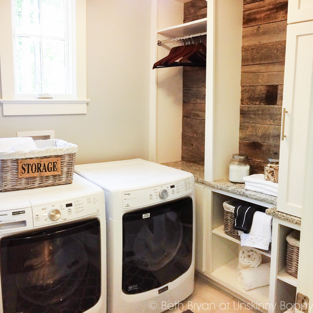 Reclaimed wood in the laundry room = Birmingham Parade of Homes Decor Ideas