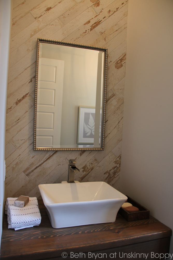 Think this is reclaimed wood? Think again. It's tile!   Birmingham Parade of Homes Decor Ideas - bathroom backsplash.