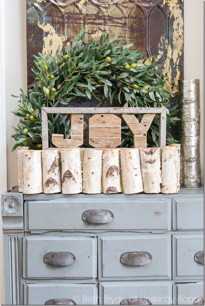 Holiday decorations on an old apothecary cabinet-- Great Christmas Decorating Ideas inside this post!
