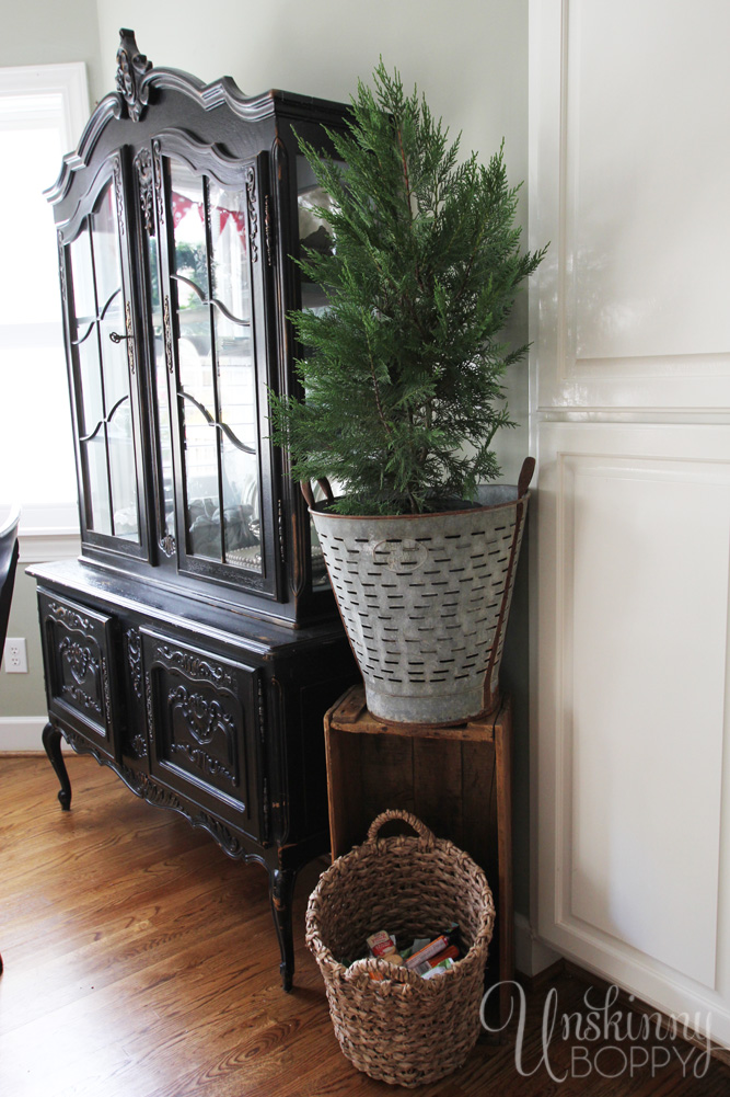 Use an olive bucket on a crate as a plant stand