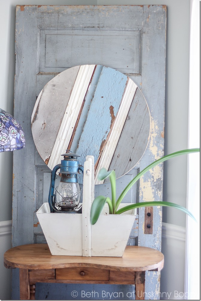 Love this idea-wooden door in the corner with a small table and pretty tiffany style lamp
