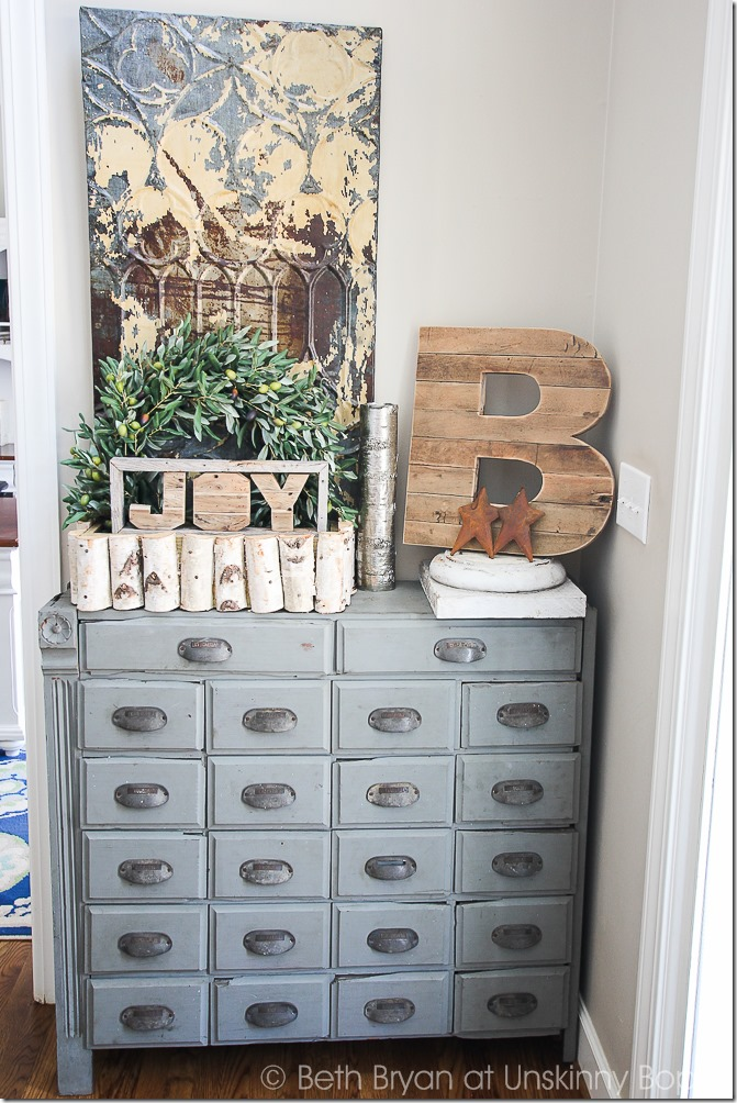 Pretty light blue apothecary cabinet.  Love that wooden B and the birch log basket, too.