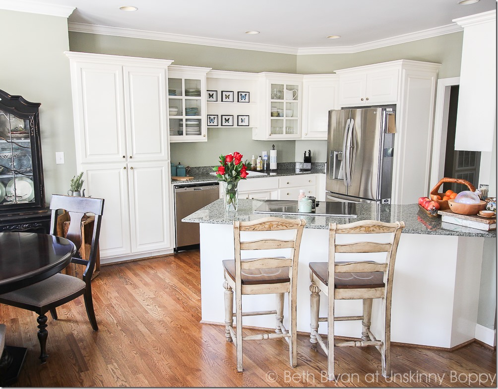White kitchen with green granite counters