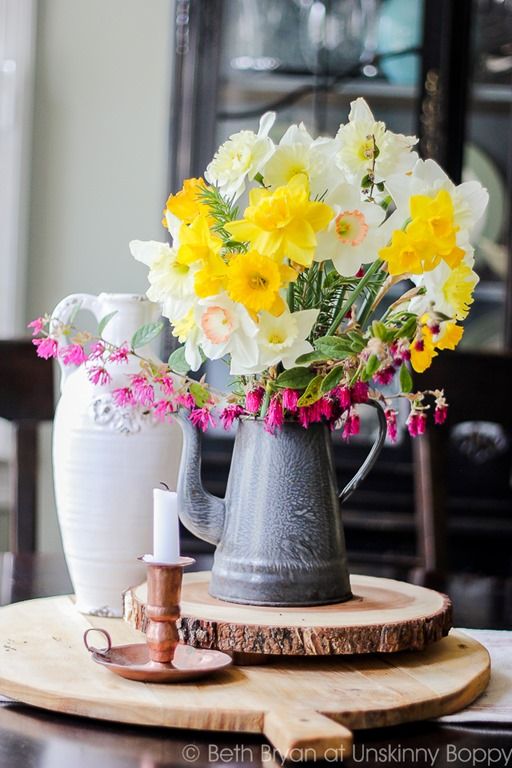 Cut Flower arrangement: Daffodils, Rosemary and Loropetalum in a teapot