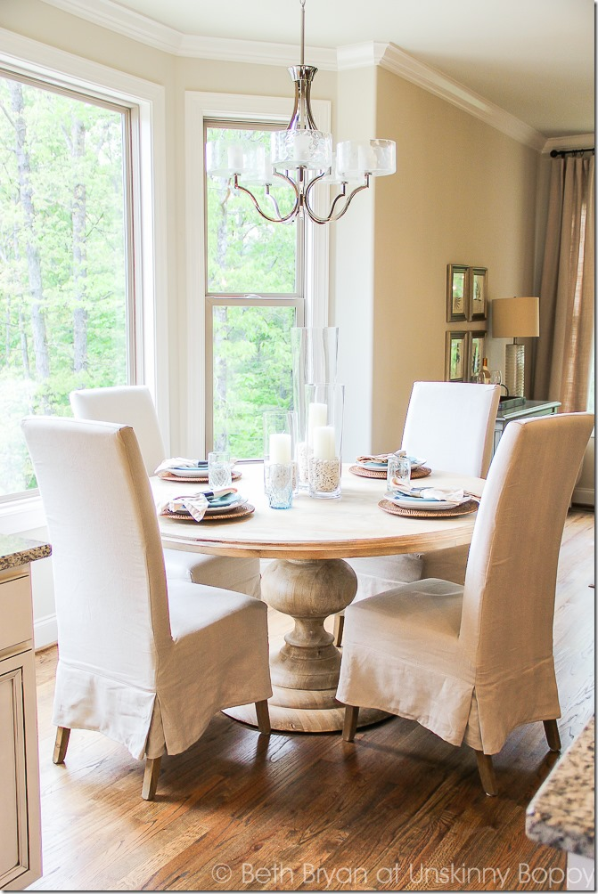 Light wood #Pedestal #dining #table in eat-in-kitchen #diningroom