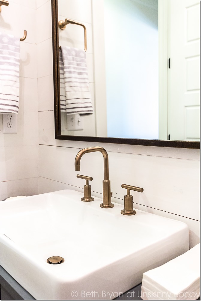 aged bronze bathroom fixtures with shiplap - modern bath
