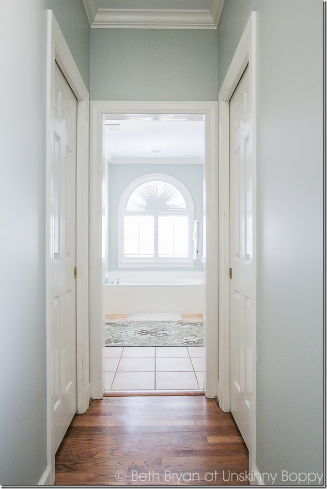 This hallway is the master bathroom entry in our master bedroom and it didn't have a door when we moved in! Here's how we added a door to this cased opening.