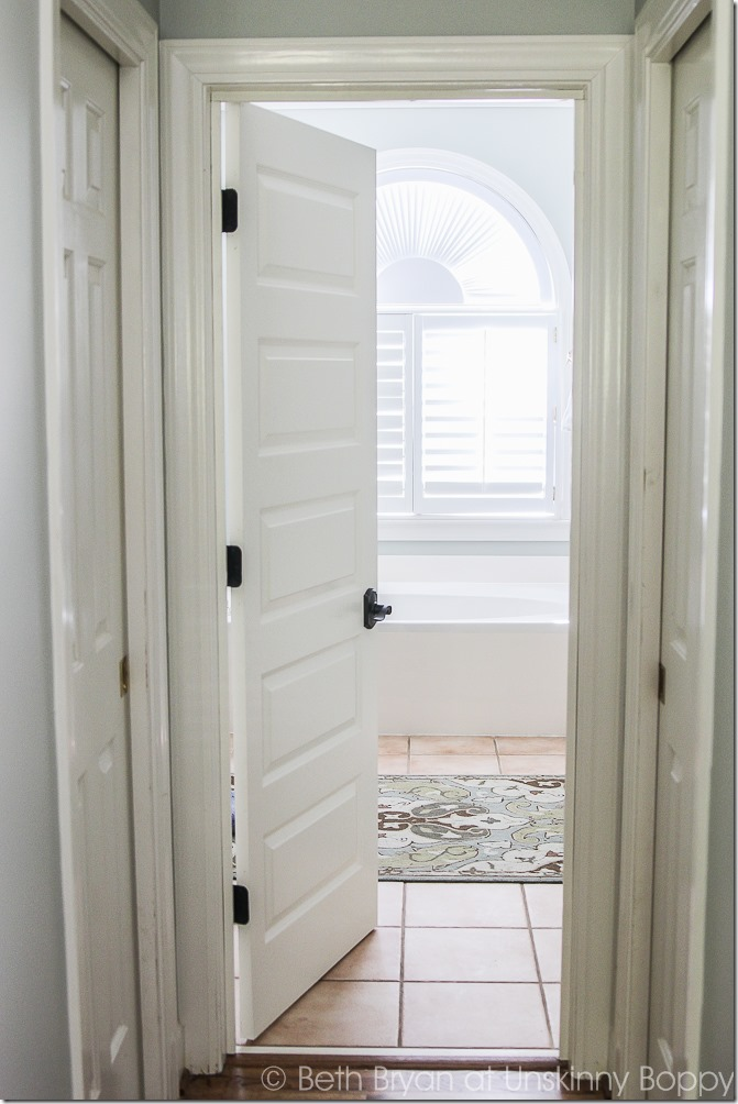 We added a door to the cased opening in our master bedroom. It's a simple DIY project that's the perfect privacy solution!