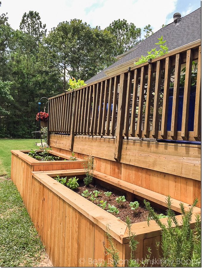 Backyard landscaping with raised garden beds-7