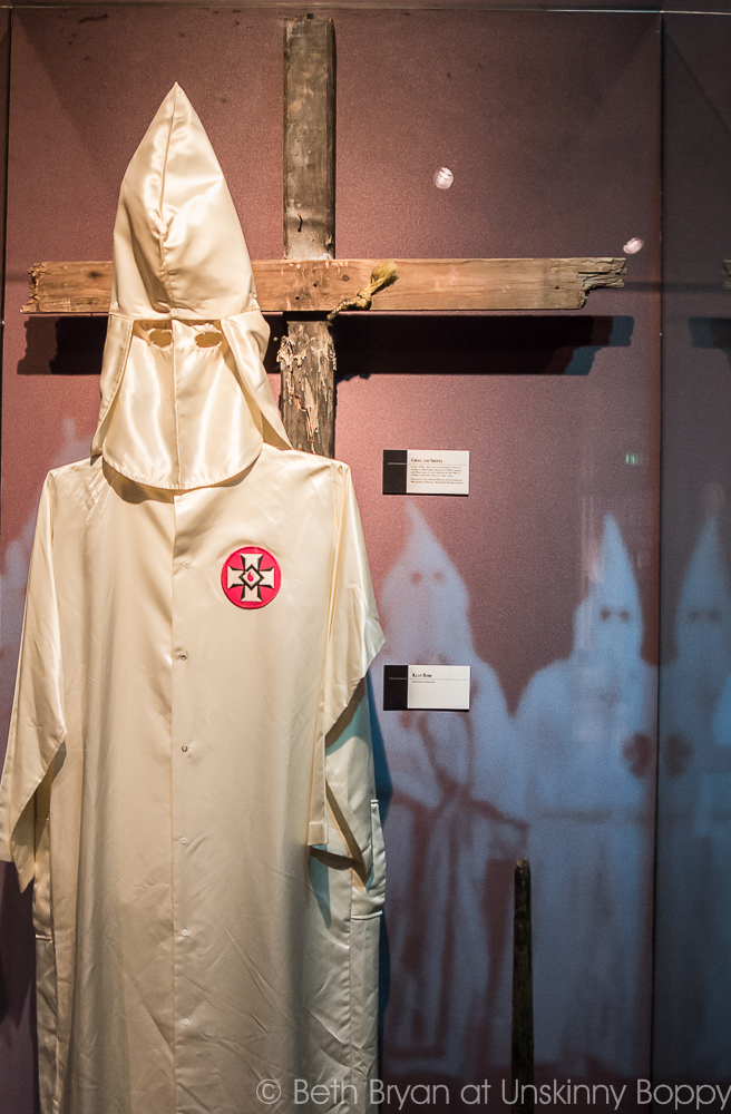 KKK robe and wooden cross on display at the Birmingham Civil Rights Institute - a glimpse into the history of Birmingham Alabama