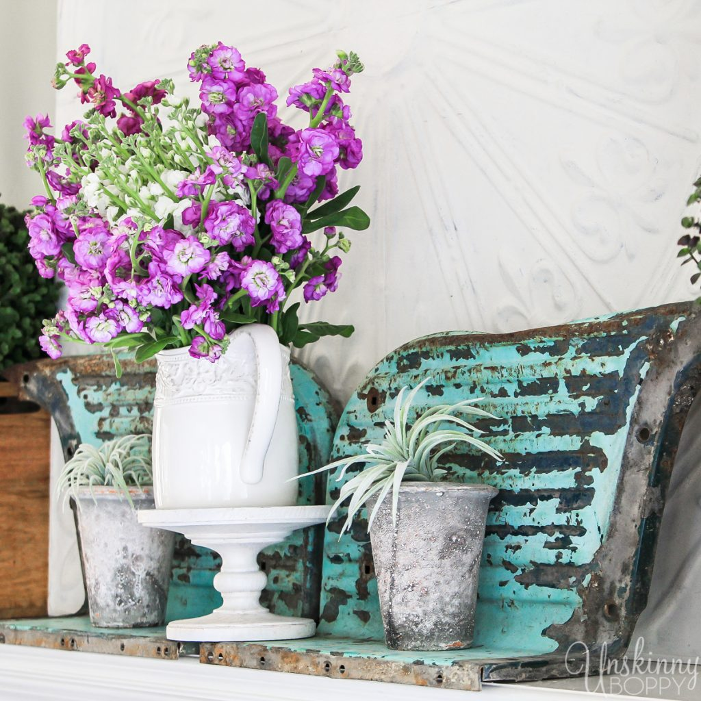 Old truck fenders turned upside down look like butterfly wings! Check out this unique and rustic mantel decor / Spring Home Tour by Unskinny Boppy