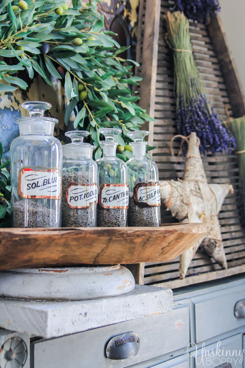 Vintage glass apothecary jars with glass labels filled with dried lavender
