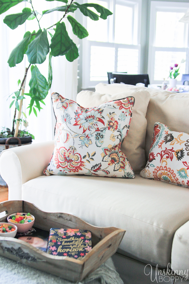 Orange and light blue Jacobean print throw pillows from Homegoods