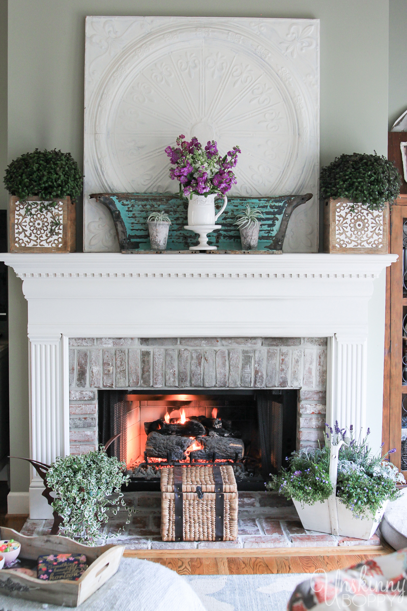Fireplace mantel decorated for Spring- white/teal/purple theme.