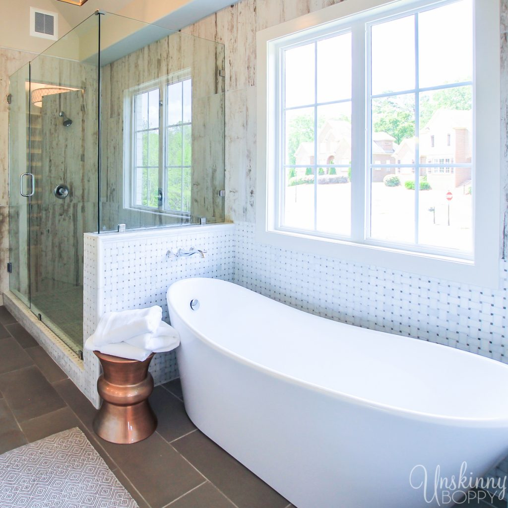 Huge soaking tub and glass shower in master bath