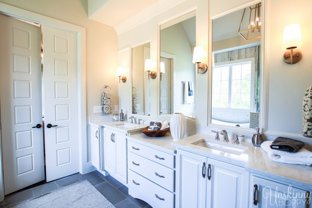 Master bathroom cabinetry with separate mirrors