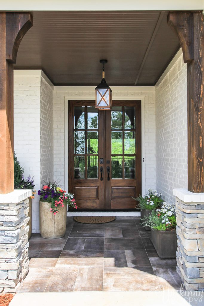 Pretty front porch with rustic wood and stone columns
