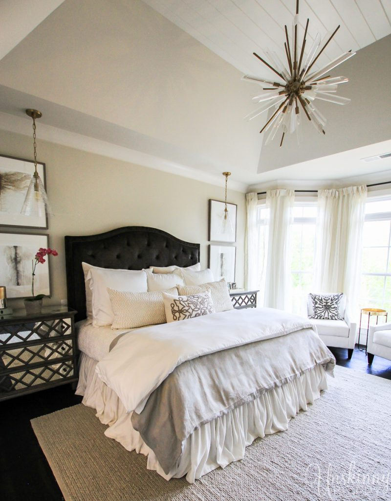 Beautiful master bedroom with ruffled bed skirt