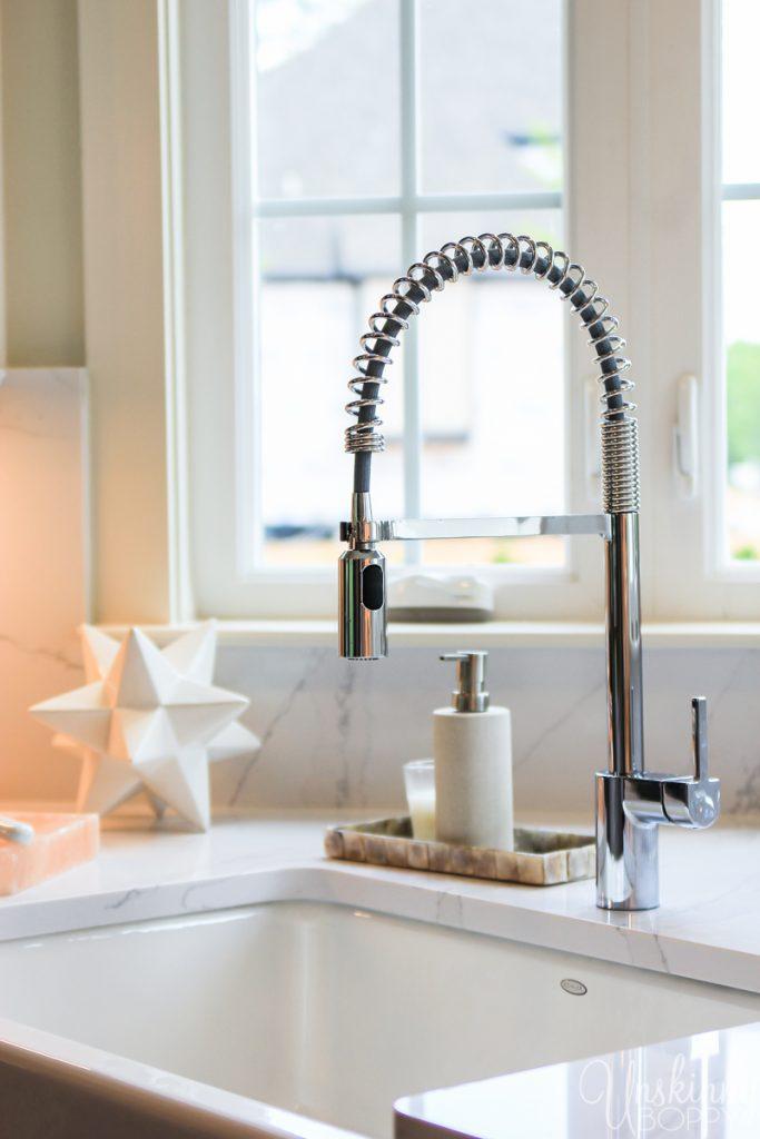 Corner sink in kitchen with windows
