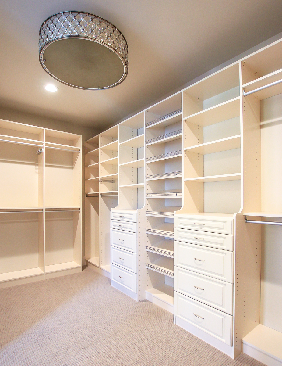 Giant master closet with drum lighting