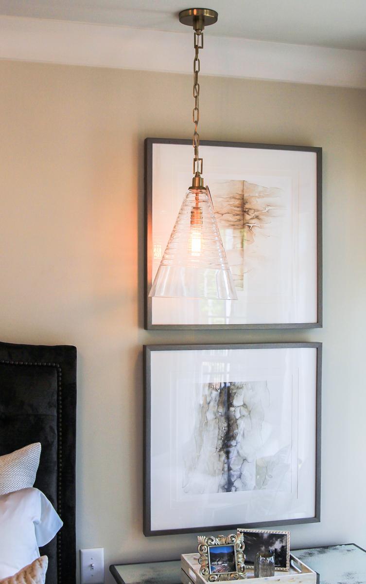 Pendant lighting over nightstand