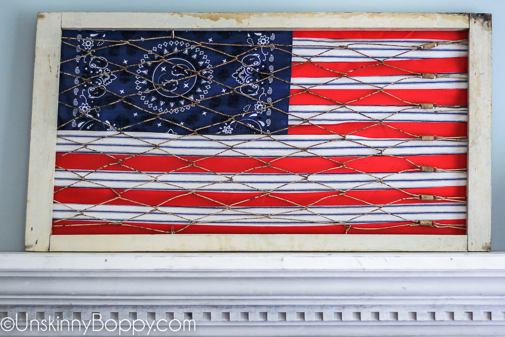 Vintage crib springs used to make flag with ribbon and handkerchief